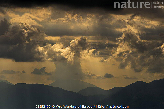 Sun shining through clouds, Pollino National Park, Basilicata, Italy, May 2009  ,  ABETE,ATMOSPHERIC,BASILICATA,CLAUDIA M�LLER,CLOUDS,DELL',EUROPE,ITALY,LANDSCAPES,NP,RESERVE,SERRA,SILHOUETTES,SUNSHINE,WWE,Weather,National Park  ,  Wild Wonders of Europe / Müller