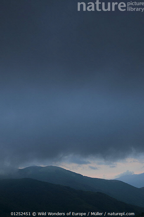 Dark clouds over hills, Pollino National Park, Basilicata, Italy, June 2009  ,  BAD,BLACK,CLAUDIA M�LLER,CLOUDS,DUSK,EUROPE,ITALY,LANSCAPES,NP,RESERVE,SILHOUETTES,VERTICAL,WEATHER,WWE,National Park  ,  Wild Wonders of Europe / Müller