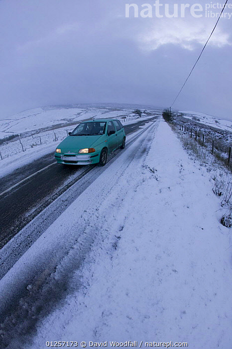 Car driving along moorland road in bad snow conditions, Denbigh Moor, Denbighshire, Wales, December 2009, bad,cars,COLD,EUROPE,EXTREME,LANDSCAPES,MOORLAND,ROADS,SNOW,UK,VEHICLES,WALES,WEATHER,WINTER, United Kingdom, David Woodfall