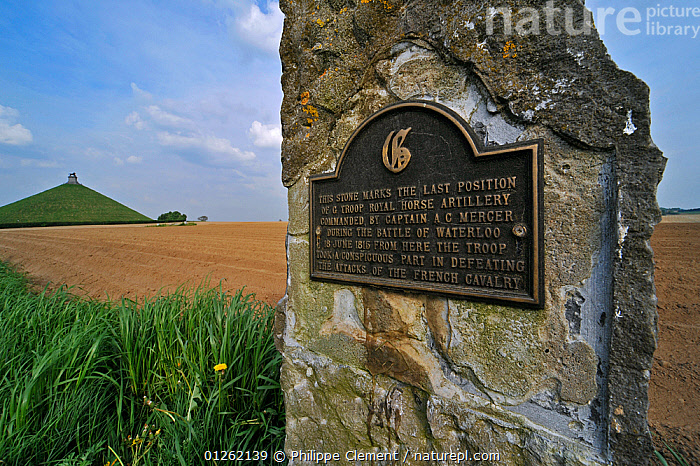 Commemorative stone and plaque near battlefield of the Battle of Waterloo, Eigenbrakel, Belgium, with Lion Hill memorial in the background.  ,  BATTLE,BELGIUM,EUROPE,HISTORICAL,LANDSCAPES,MEMORIALS,SIGNS,WARS  ,  Philippe Clement