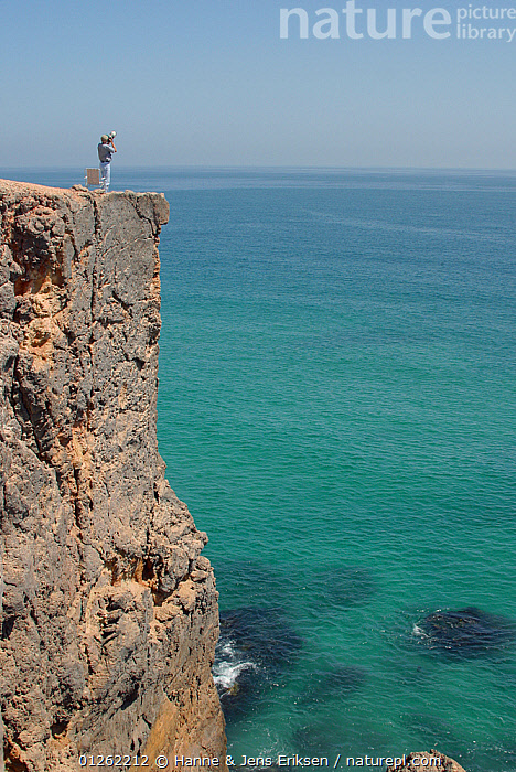 Coastal cliffs at Ras al Khabbah, a good spot for birdwatching during migration, Oman  ,  ARABIA,CLIFFS,COASTS,MIDDLE EAST,PEOPLE,SEA,VERTICAL,Geology  ,  Hanne & Jens Eriksen