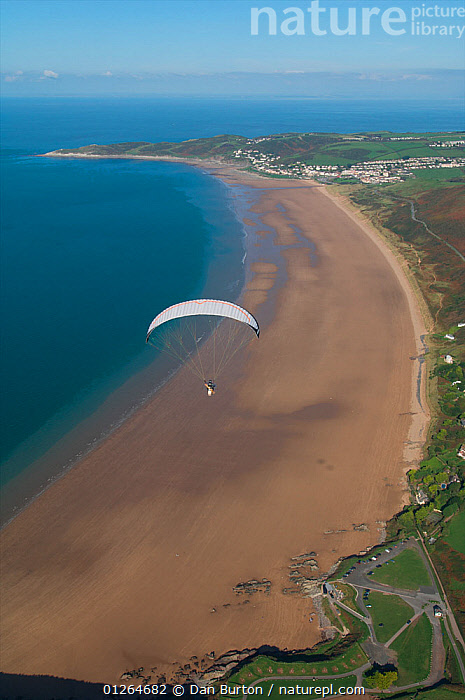 Aerial view of a paraglider over Woolacombe beach, North Devon, UK, October 2009  ,  AERIALS,BEACHES,COASTS,EUROPE,LANDSCAPES,LEISURE,PARAGLIDING,UK,VERTICAL,VILLAGES,SPORTS, United Kingdom  ,  Dan Burton