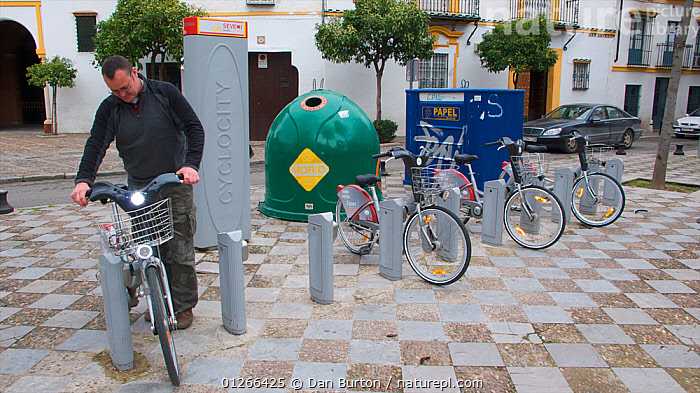 Bicycles for hire on street in Seville, Spain.  ,  BICYCLES,BIKE,CITIES,CYCLE,CYCLES,CYCLING,ENVIRONMENTAL,EUROPE,PEOPLE,ROADS,SPAIN,TRANSPORT  ,  Dan Burton