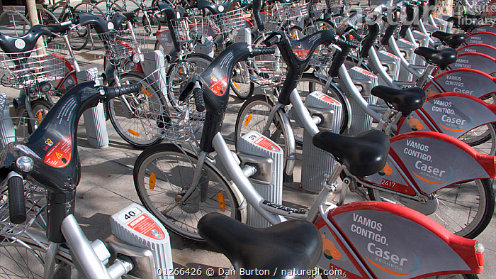 Bicycles for hire on street in Seville, Spain.  ,  BICYCLES,BIKE,CITIES,CROWDS,CYCLE,CYCLES,CYCLING,ENVIRONMENTAL,EUROPE,ROADS,SPAIN,TRANSPORT  ,  Dan Burton