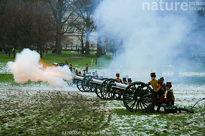 The King's Troops, Royal Horse Artillery, fire a WWI canon to celebrate the Queen's Accession to the Throne, Hyde Park, London, England, UK. November 2009  ,  CEREMONY,CITIES,EUROPE,GUNS,PARKLAND,PEOPLE,RIDING,ROYAL,SMOKE,SNOW,TRADITIONAL,UK, United Kingdom  ,  Kristel Richard