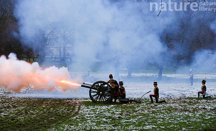 The King's Troops, Royal Horse Artillery, fire a WWI canon to celebrate the Queen's Accession to the Throne, Hyde Park, London, England, UK. November 2009  ,  CEREMONY,CITIES,EUROPE,GUNS,LANDSCAPES,PARKLAND,PEOPLE,SMOKE,SNOW,SOLDIERS,TRADITIONAL,UK, United Kingdom  ,  Kristel Richard