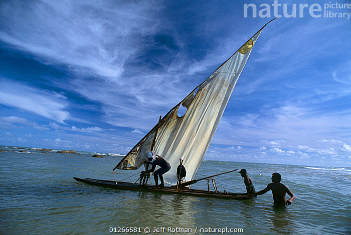 Traditional fisherman pushing raft out into ocean, Recife, Brazil, Atlantic Ocean, January 2008  ,  ATLANTIC,BOATS,Brazil,Fisherman,Fishermen,FISHING,LANDSCAPES,MARINE,PEOPLE,SOUTH AMERICA,sustainable,TRADITIONAL,SOUTH-AMERICA  ,  Jeff Rotman