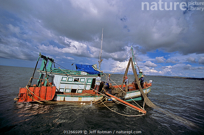 Fishing dragger boat,  Sihanoukville, Cambodia / Kampuchea, June 2008  ,  ASIA,BOATS,CAMBODIA,COASTS,COMMERCIAL,FISHERIES,FISHING,FISHING BOATS,INDO PACIFIC,nets,PEOPLE,sea,SOUTH-EAST-ASIA  ,  Jeff Rotman