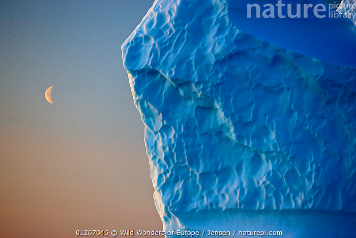 Edge of iceberg with the moon in the sky, Greenland, August 2009  ,  ARCTIC,BLUE,EUROPE,GREENLAND,ICE,ICEBERGS,KAI JENSEN,LANDSCAPES,MOON,WWE  ,  Wild Wonders of Europe / Jensen