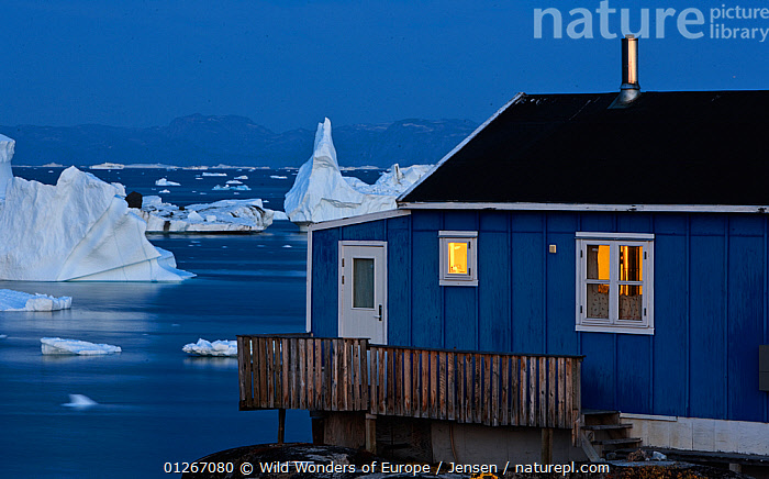 House on the coast with icebergs in the distance, Saqqaq, Greenland, August 2009  ,  ARCTIC,BUILDINGS,COASTS,DUSK,EUROPE,GREENLAND,ICE,ICEBERGS,KAI JENSEN,LANDSCAPES,WWE  ,  Wild Wonders of Europe / Jensen