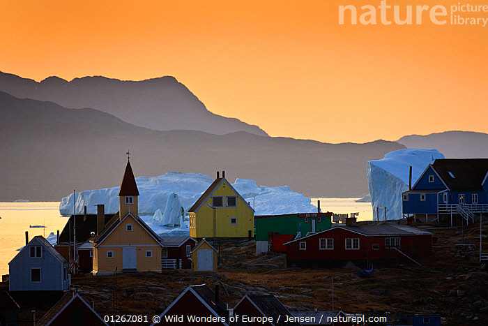 Houses and church in Saqqaq with icebergs on the sea, at sunrise, Disko Bay, Greenland, August 2009  ,  ARCTIC,BUILDINGS,COASTS,DAWN,DISCOBAY,EUROPE,GREENLAND,ICEBERGS,KAI JENSEN,LANDSCAPES,ORANGE,SUNRISE,VILLAGES,WWE  ,  Wild Wonders of Europe / Jensen