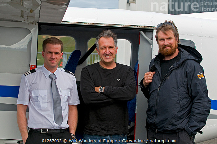 Pilot, Steindor Kristinn Jonsson, Photographer, Mark Carwardine and Whale spotter, Heimir Hardarson standing in front of plane used for Wild Wonders of Europe mission, Husavik, Northern Iceland, July 2009  ,  AEROPLANES,EUROPE,ICELAND,MARK CARWARDINE,PEOPLE,THREE,WWE  ,  Wild Wonders of Europe / Carwardine
