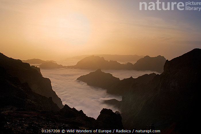 View of mountains surrounded by low clouds from Pico do Arieiro, Madeira, March 2009  ,  CLOUDS,EUROPE,LANDSCAPES,MILAN RADISICS,MIST,MOUNTAINS,PORTUGAL,ROCKS,SILHOUETTES,SUN,WWE,Weather  ,  Wild Wonders of Europe / Radisics