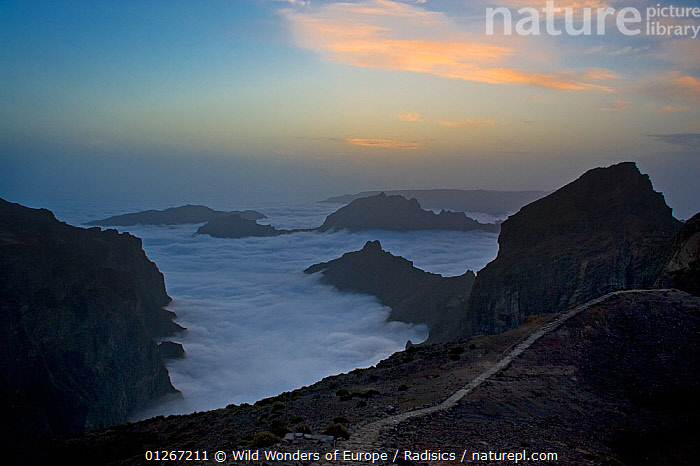 Mountains surrounded by low lying cloud, with a path on Pico do Arieiro, Madeira, March 2009  ,  CLOUDS,EUROPE,LANDSCAPES,MILAN RADISICS,MOUNTAINS,PORTUGAL,ROCKS,SILHOUETTES,WWE,Weather  ,  Wild Wonders of Europe / Radisics