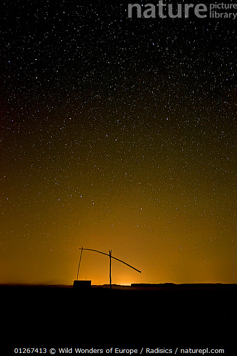 Water well silhouetted at night, in Hortobagy National Park, Hungary, July 2009  ,  EASTERN EUROPE,EUROPE,HUNGARY,LANDSCAPES,MILAN RADISICS,NIGHT,NP,RESERVE,SILHOUETTES,STARS,VERTICAL,WWE,National Park  ,  Wild Wonders of Europe / Radisics