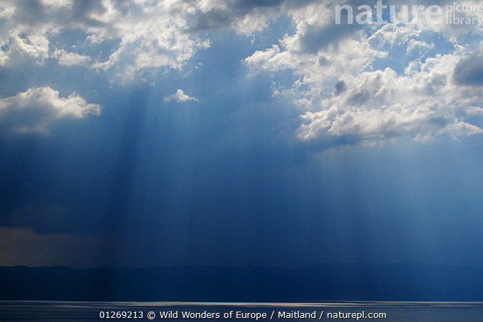 Ray of light shining through thunder clouds over Lake Ohrid, Galicica National Park, Macedonia, June 2009  ,  ATMOSPHERIC,BLUE,CLOUDS,DAVID MAITLAND,EUROPE,LAKES,LANDSCAPES,MACEDONIA,NP,RESERVE,STORMS,SUNSHINE,WWE,Weather,National Park  ,  Wild Wonders of Europe / Maitland