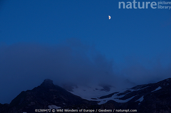 View of clouds over mountain at dusk near the Pf�lzer H�tte, Liechtenstein, June 2009  ,  ALPINE,ALPS,BLUE,CLOUDS,DUSK,EDWIN GIESBERS,EUROPE,LANDSCAPES,LIECHTENSTEIN,MOON,NIGHT,SNOW,WWE,Weather  ,  Wild Wonders of Europe / Giesbers