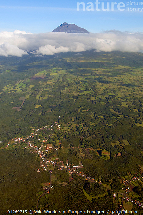 Aerial view of village and countryside with Mt Pico and clouds in the distance, Azores, June 2009  ,  AERIALS,ATLANTIC ISLANDS,CLOUDS,EUROPE,LANDSCAPES,MAGNUS LUNDGREN,MOUNTAINS,PORTUGAL,VERTICAL,VILLAGES,WWE,Weather  ,  Wild Wonders of Europe / Lundgren