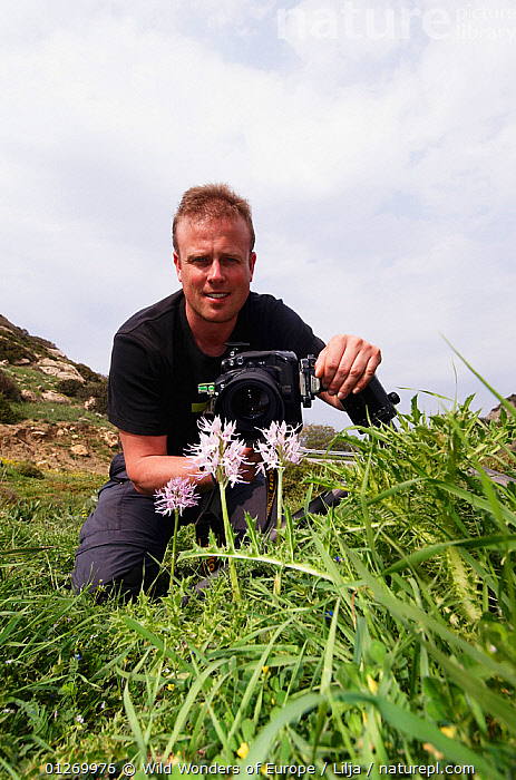 Peter Lilja photographing a Naked man orchid (Orchis italica) in flower, Kayalar, Northern Cyprus, April 2009, CAMERAS,CYPRUS,EUROPE,FLOWERS,MONOCOTYLEDONS,ORCHIDACEAE,PEOPLE,PETER LILJA,PHOTOGRAPHERS,PLANTS,VERTICAL,WWE, Wild Wonders of Europe / Lilja