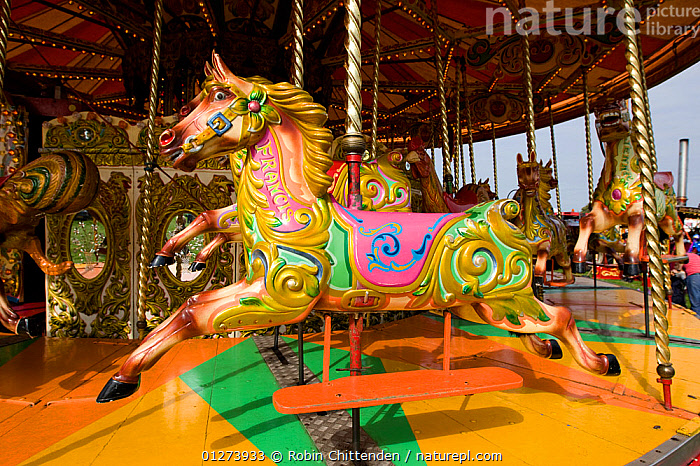 Horses on merry-go-round, Hengate, Suffolk, England, September 2008  ,  CAROUSEL,COLOURFUL,ENTERTAINMENT,EUROPE,FAIRS,FUN,HORSES,ROUNDABOUT,UK, United Kingdom  ,  Robin Chittenden