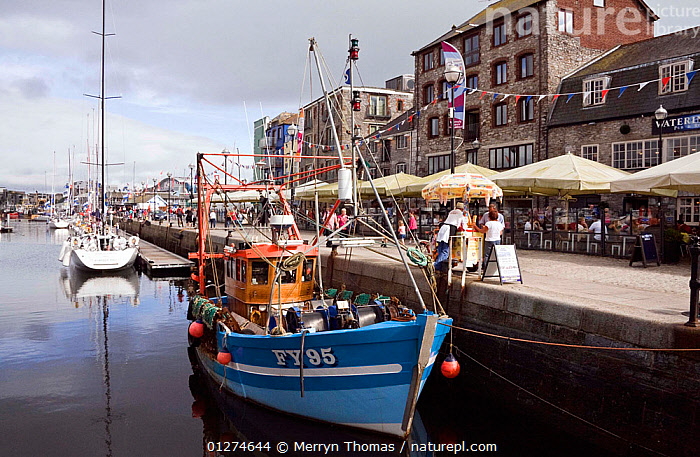 Fishing boat moored alongside quay in the historic Barbican, Plymouth, Devon. August 2009.  ,  CITIES,COASTS,EUROPE,FISHING BOATS,FRONT VIEWS,HARBOURS,HISTORICAL,LANDSCAPES,TRAWLERS,UK,BOATS, WORKING-BOATS , United Kingdom  ,  Merryn Thomas
