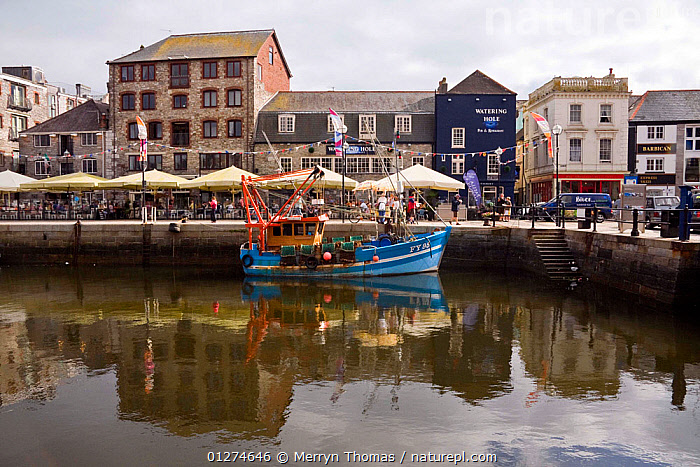Fishing boat moored alongside quay in the historic Barbican, Plymouth, Devon. August 2009.  ,  BUILDINGS,CITIES,COASTS,EUROPE,FISHING BOATS,HARBOURS,HISTORICAL,LANDSCAPES,PROFILE,REFLECTIONS,TRAWLERS,UK,BOATS, WORKING-BOATS , United Kingdom  ,  Merryn Thomas