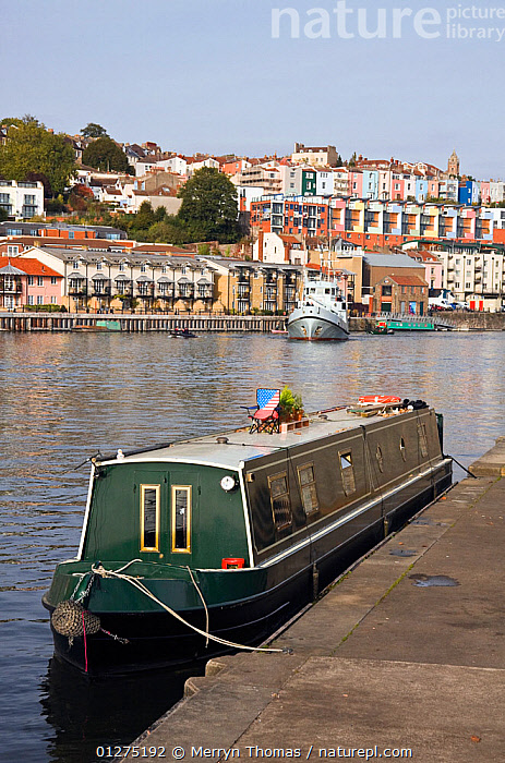 Narrow boat moored on Bristol Harbour, October 2009.  ,  CANAL BOATS,CITIES,EUROPE,FLOATING HARBOUR ,HARBOURS,MOORED,UK,VERTICAL, United Kingdom  ,  Merryn Thomas