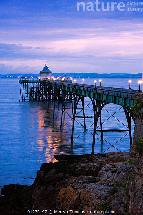 Clevedon Pier at dusk, Somerset. August 2009. (This image may be licensed either as rights managed or royalty free.)  ,  COASTS,DUSK,ESTUARY,EUROPE,HISTORICAL,LANDSCAPES,LIGHTS,PIERS,RIVERS,SEVERN,UK,VERTICAL, United Kingdom,RF, royalty free, RF3,,RF3,,RF,  ,  Merryn Thomas
