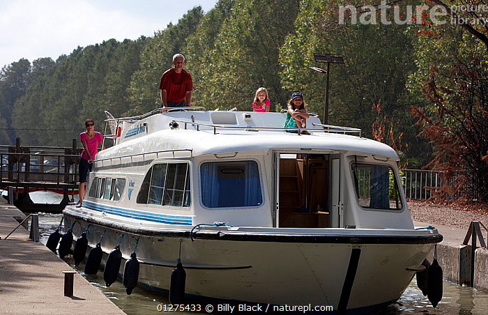 Family cruising on the Canal Du Midi near Beziers, Languedoc, France. July 2009. Model and property released.  ,  CANALS,CRUISING,EUROPE,FAMILIES,FRANCE,FRONT VIEWS,LIFESTYLE,LOCK,LOCKS,MOTORBOATS,BOATS  ,CONCEPTS ,core collection xtwox  ,  Billy Black