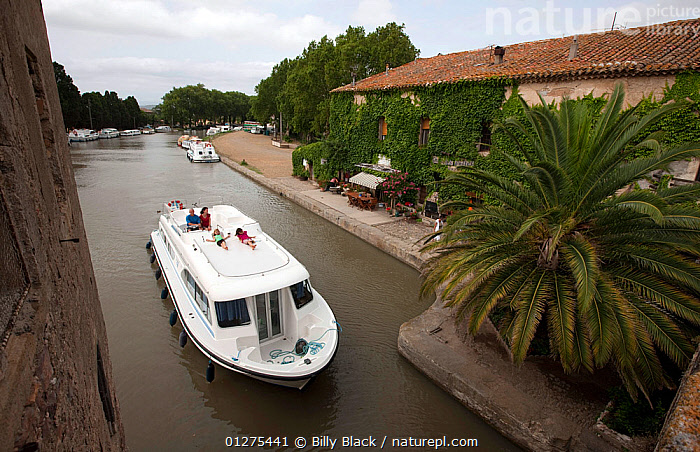 Family cruising on the Canal Du Midi around Le Somail, France. July 2009. Model released.  ,  CANALS,CRUISING,EUROPE,FAMILIES,FRANCE,HIGH ANGLE SHOT,HOLIDAYS,LANDSCAPES,LIFESTYLE,MOTORBOATS,TOWNS,BOATS  ,CONCEPTS ,core collection xtwox  ,  Billy Black