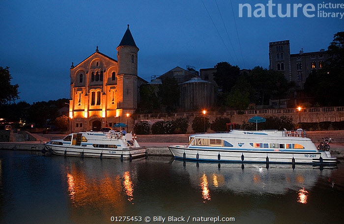 Boats moored at dusk on the Canal Du Midi, Ventenac-en-Minervois, Aude, Languedoc, southern France. July 2009.  ,  BUILDINGS,CANALS,CRUISING,DUSK,EUROPE,FRANCE,LANDSCAPES,MOORED,MOTORBOATS,REFLECTIONS,TWO,BOATS  ,  Billy Black