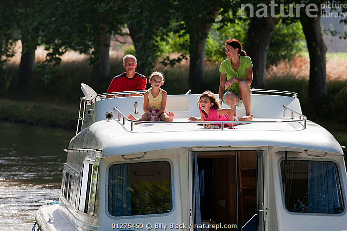 Family cruising on the Canal Du Midi near Aiguille, southern France. July 2009. Model and property released.  ,  CANALS,CRUISING,EUROPE,FAMILIES,FRANCE,FRONT VIEWS,HOLIDAYS,LEISURE,LIFESTYLE,MOTORBOATS,SUMMER,BOATS  ,CONCEPTS ,core collection xtwox  ,  Billy Black