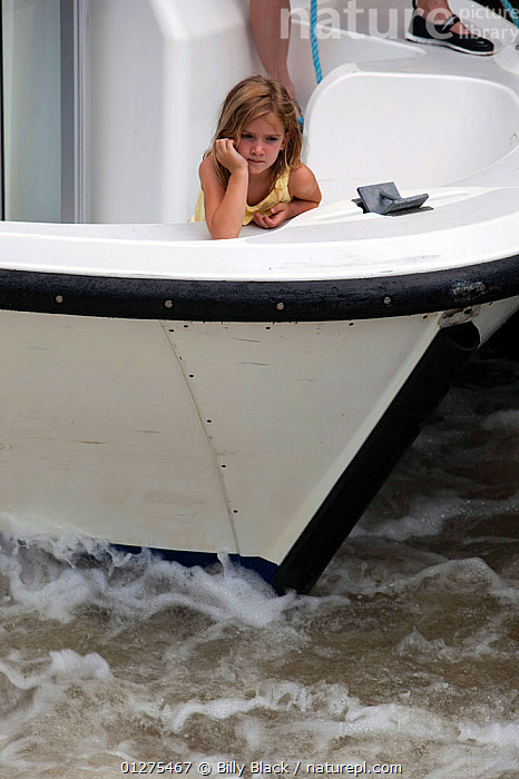 Little girl on bow of boat cruising on the Canal Du Midi near Homps, southern France. July 2009. Model and property released.  ,  BOWS,CANALS,CHILDREN,CRUISING,EUROPE,FRANCE,MOTORBOATS,VERTICAL,WATCHING,BOATS  ,core collection xtwox,BOAT-PARTS  ,  Billy Black