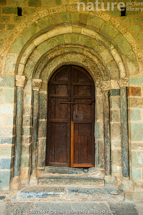 Doorway of entrance to Church of the nativity, Durro. Romanesque church from XII century, and UNESCO world heritage, in the Bo� Valley, Pyrenees, Lleida, Catalonia, Spain. July 2009  ,  ANCIENT,BUILDINGS,CHURCHES,DOORS,EUROPE,SPAIN,VERTICAL  ,  Inaki Relanzon