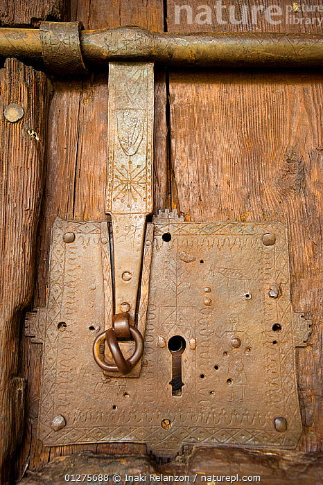 Door lock of Church of the nativity, Durro. Romanesque church from XII century, and UNESCO world heritage, in the Bo� Valley, Pyrenees, Lleida, Catalonia, Spain. July 2009  ,  BUILDINGS,CHURCHES,CLOSE UPS,EUROPE,SPAIN,VERTICAL  ,  Inaki Relanzon
