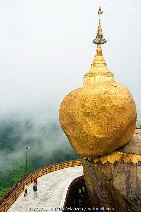 The Golden Rock in Kyaiktiyo, one of the most important buddhist temple in Myanmar / Burma.  August 2009  ,  ASIA,BUDDHISM,BUILDINGS,BURMA,CLOUDS,GOLD,MOUNTAINS,PAGODAS,PEOPLE,RELIGIONS,SOUTH EAST ASIA,TEMPLES,VERTICAL,Weather  ,  Inaki Relanzon
