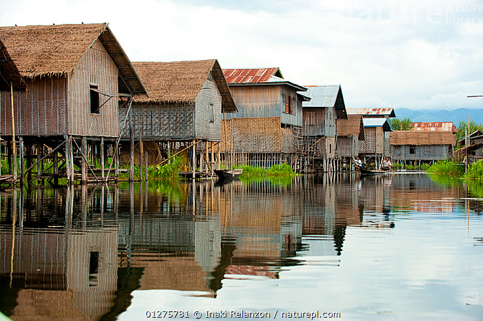 Row of floating houses in the waters of Inle Lake, Shan State, Myanmar, Burma. August 2009  ,  ASIA,BURMA,CULTURES,HOUSE,REFLECTIONS,SOUTH EAST ASIA,TRADITIONS,VILLAGES,WATER  ,  Inaki Relanzon
