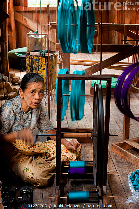 Woman working in a traditional silk factory, Inle Lake, Shan State, Myanmar,  Burma August 2009  ,  ASIA,BURMA,CLOTH,CULTURES,FABRICS,SOUTH EAST ASIA,TEXTILES,TRADITIONS,VERTICAL,WOMEN,WORKING  ,  Inaki Relanzon