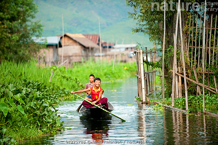 Two young boys in a traditional boat,  rowing up a river, Inle Lake, Shan State, Myanmar, Burma. August 2009  ,  BOATS,BOYS,CULTURES,PEOLE,PLAY,PLAYING,RIVERS,SMILING,TRADITIONS,VILLAGES,Communication,core collection xtwox  ,  Inaki Relanzon