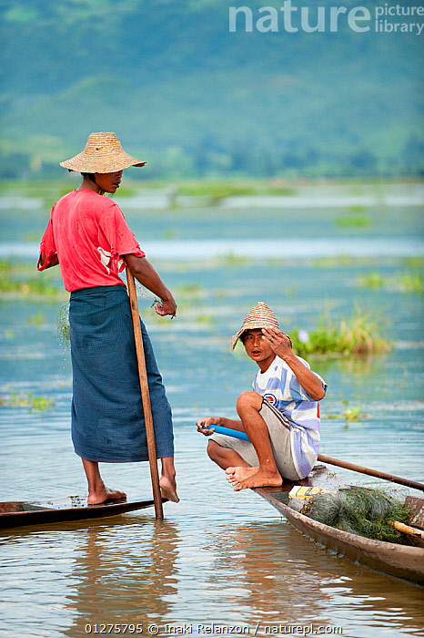 Two Traditional fishermen. These fishermen row with their feet,   Inle Lake, Shan State, Myanmar, Burma. August 2009  ,  ASIA,BOATS,BURMA,CULTURES,FISHING,LAKES,PEOPLE,ROWING,SOUTH EAST ASIA,TRADITIONS,TWO,VERTICAL,WATER  ,  Inaki Relanzon