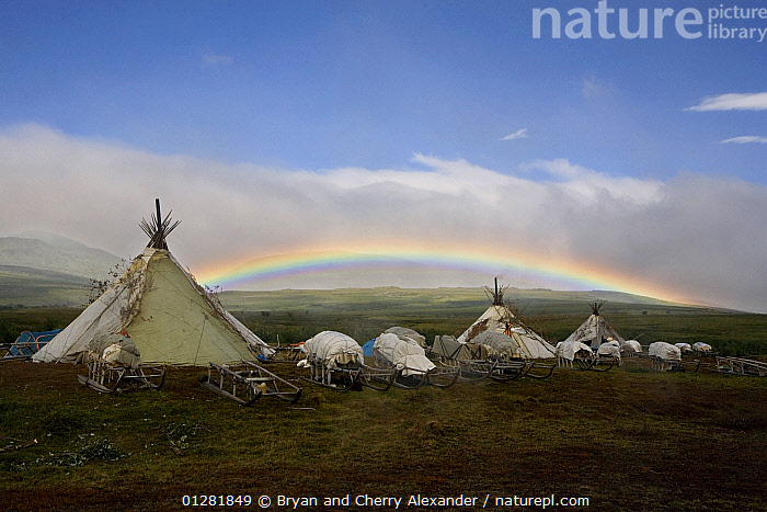 Rainbow over Khanty reindeer herders' camp in the Polar Ural Mountains. Yamal, Western Siberia, Russia, Summer 2007.  ,  AGRICULTURE,ARCTIC,ASIA,CAMPING,HOMES,Indigenous,MOUNTAINS,native,RAINBOWS,RUSSIA,sledges,sleds,tent,tents,TRADITIONAL,TRIBES,Weather,CIS  ,  Bryan and Cherry Alexander