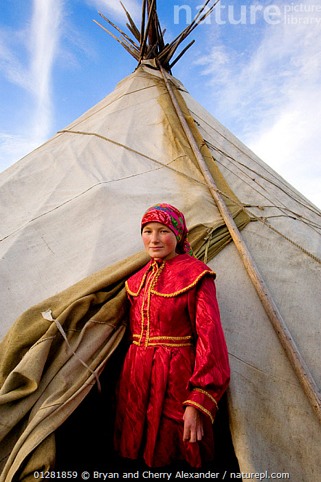 Khanty woman standing at the entrance to her family's tent in the Polar Ural Mountains, Yamal, Western Siberia, Russia, Summer 2007. Editorial use only.  ,  ARCTIC,ASIA,Asian,CLOTHING,HOMES,Indigenous,native,PEOPLE,PORTRAITS,RUSSIA,Siberia,tent,tents,TRADITIONAL,TRIBES,VERTICAL,WOMAN,CIS  ,  Bryan and Cherry Alexander