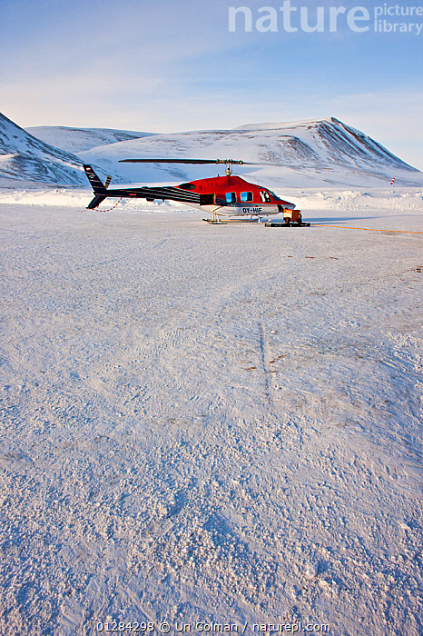 Helicopter, Air Greenland, local transport, Constaple Point, North East Greenland. February 2009.  ,  ARCTIC,COLD,EMERGENCIES,EMERGENCY,ENVIRONMENTAL,EUROPE,ISOLATED,ISOLATION,LANDSCAPES,MOUNTAINS,PASSENGERS,REMOTE,RESCUE,SERVICES,SNOW,TRANSPORT,TRANSPORTATION,VEHICLES,VERTICAL,WINTER  ,  Uri Golman