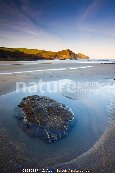 Rockpool on the sandy beach at Crackington Haven, Cornwall, England. April 2009  ,  ATMOSPHERIC,BEACHES,CALM,COASTS,EUROPE,LANDSCAPES,PEACEFUL,ROCK POOL,SAND,SPRING,UK,WATER,ENGLAND,Concepts, United Kingdom  ,  Adam Burton