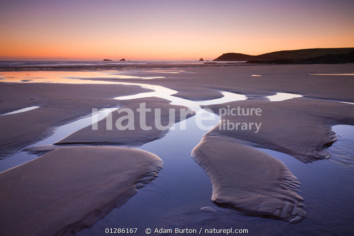 Low tide on Constantine Beach, Cornwall, England. May 2009.  ,  BEACHES,CALM,COASTS,DUSK,EMPTY,ENGLAND,EUROPE,LANDSCAPES,PEACEFUL,SUNSET,TIDES,UK,Concepts, United Kingdom  ,  Adam Burton