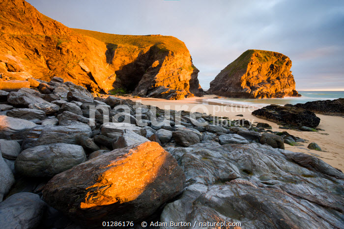 Summer evening on the shore at Bedruthan Steps, Cornwall, England. May 2009  ,  BEACHES,CLIFFS,COASTS,EUROPE,GEOLOGY,LANDSCAPES,UK,ENGLAND, United Kingdom  ,  Adam Burton