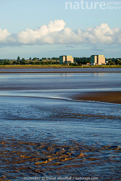 Berkeley nuclear power station (now decommissioning) on banks of Severn Estuary. England, August 2009  ,  BUILDINGS,ENERGY,ESTUARIES,EUROPE,LANDSCAPES,POWER,TIDES,UK,URBAN,VERTICAL,WATER, United Kingdom  ,  David Woodfall