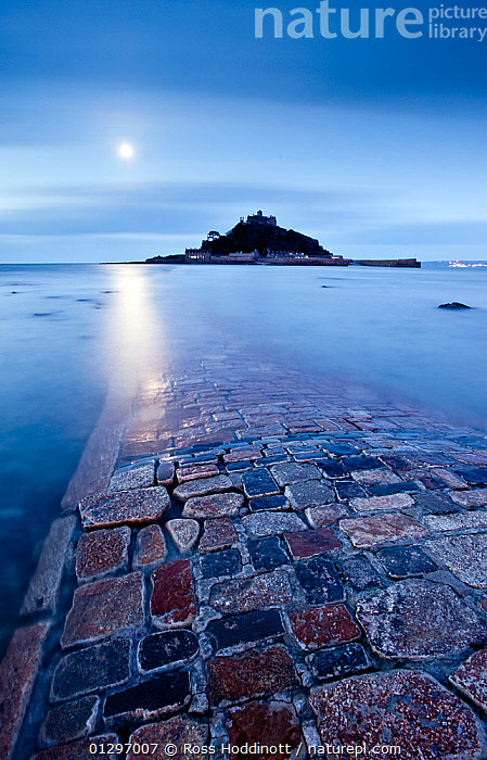 St Michael's Mount by moonlight, Marazion, West Cornwall, England, UK. March 2010., ATMOSPHERIC,COASTS,COBBLES,DRAMATIC,EUROPE,ISLANDS,LANDSCAPES,MOON,NIGHT,PATHS,REFLECTIONS,SURFACE,UK,VERTICAL,WATER,WINTER,CONCEPTS,United Kingdom, Ross Hoddinott