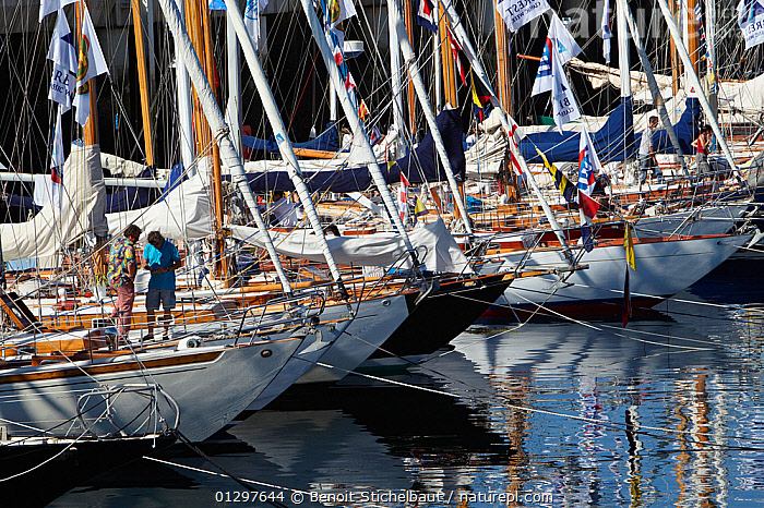 Classic yachts moored in the harbour at Brest Classic Week, Brittany, France, July 2010.  ,  BOATS,BOWS,CLASSICS,EUROPE,EVENTS,FLAGS,FRANCE,HARBOURS,MOORED,MOORING LINES,MS,SAILING BOATS,WOODEN,YACHTS  ,  Benoit Stichelbaut