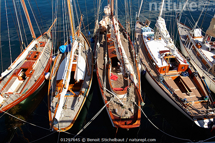 Classic yachts moored in the harbour at Brest Classic Week, Brittany, France, July 2010.  ,  BOATS,CLASSICS,DECKS ,EUROPE,EVENTS,FRANCE,HIGH ANGLE SHOT,MOORED,SAILING BOATS,WOODEN,YACHTS  ,  Benoit Stichelbaut